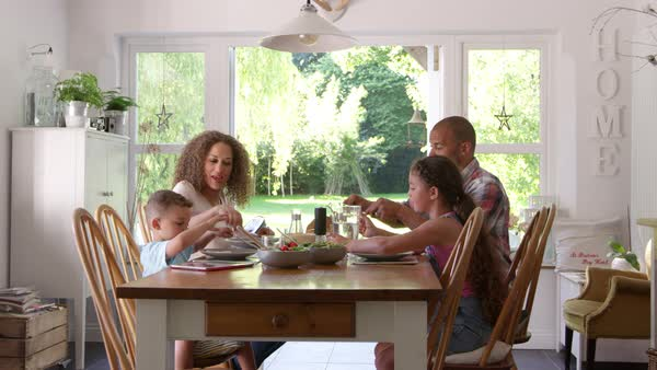 Family At Home Eating Meal In Dining Room Together Royalty-free stock video