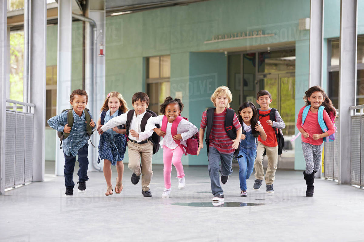 94dac9edb19 Group of elementary school kids running in a school corridor - Stock ...