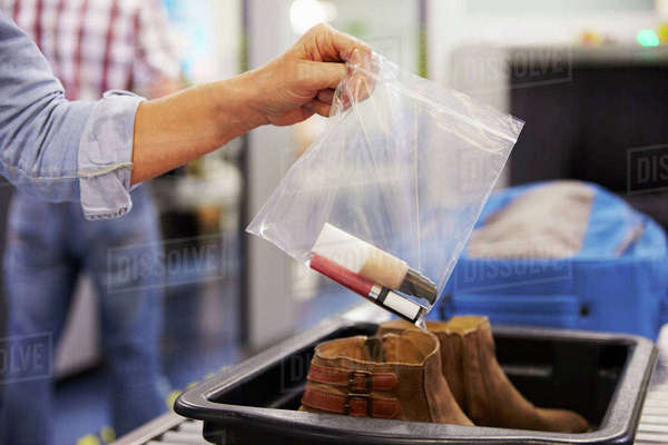 Passenger Puts Liquids Into Bag At Airport Security Check Royalty-free stock photo