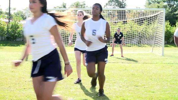 Slow motion sequence of female soccer team working with coach. Royalty-free stock video