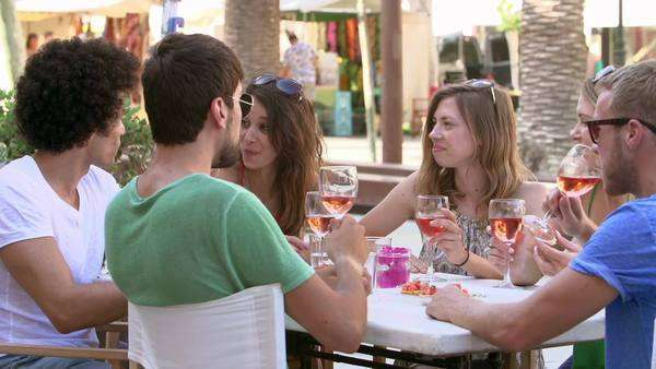 Group of young friends enjoying drink at outdoor bar Royalty-free stock video