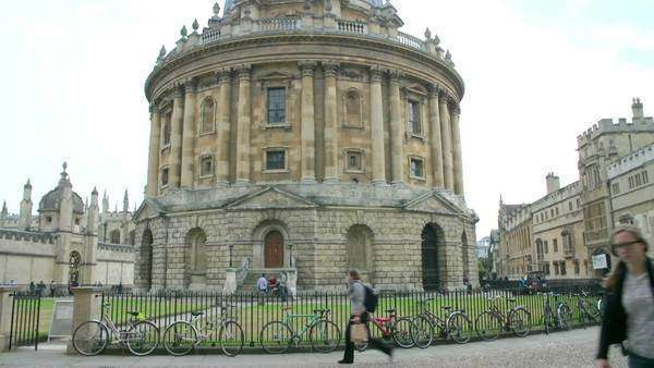 Camera pans up to show the exterior of Oxford Radcliffe Camera. Royalty-free stock video
