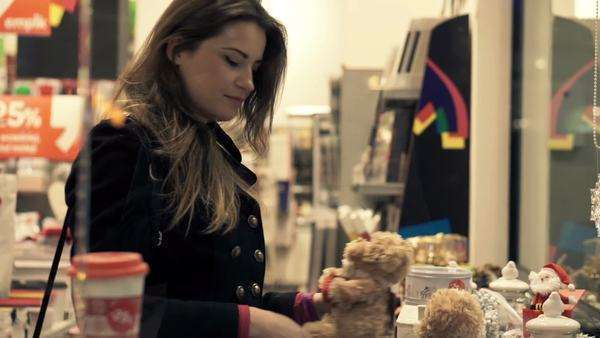 58261cb51 Young woman checking toys for Christmas gift at shopping store Royalty-free  stock video
