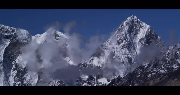 Locked off shot of an alpine scenery under blue sky Rights-managed stock video