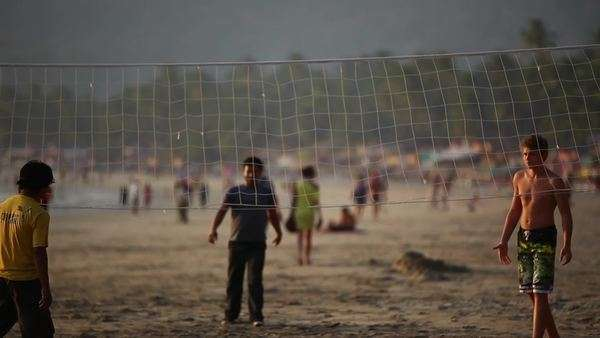 Wide shot of people playing beach volleyball in India Royalty-free stock video