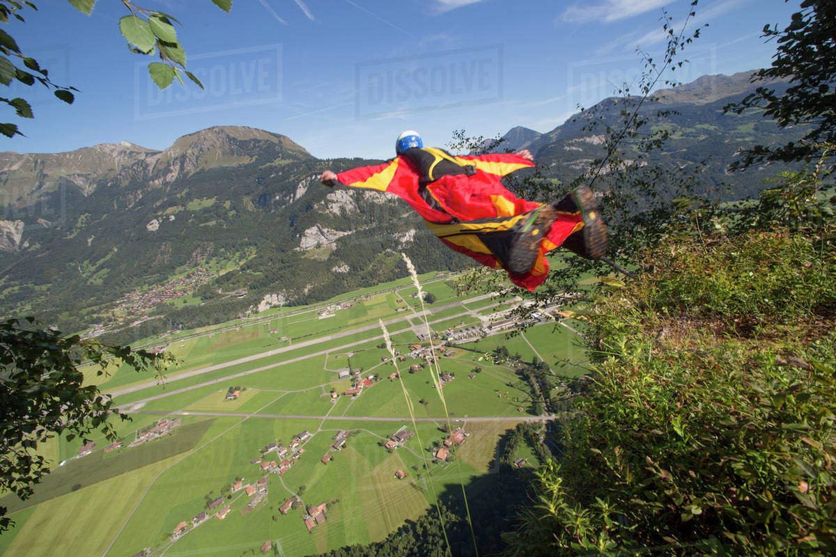 Wingsuit flyer jumping off the cliff Royalty-free stock photo