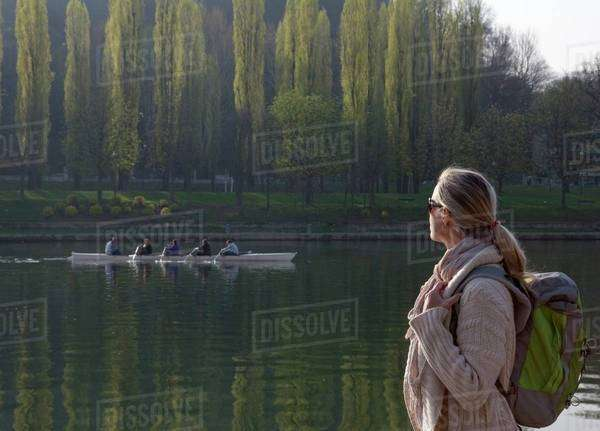 Woman watching a canoe from the riverside in Piedmont, Italy Royalty-free stock photo