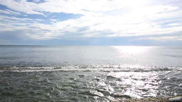 Sea surf sweeps across beach, sunny skies Royalty-free stock video
