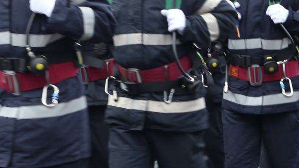 Men of the fire brigade unit with belts, buckles, tubes, uniforms walk ordered in group Royalty-free stock video