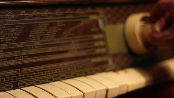 Searching in the evening for favorite radio music, on an old radio machine Royalty-free stock video