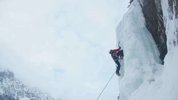 Slow motion of ice climber on her way up Royalty-free stock video