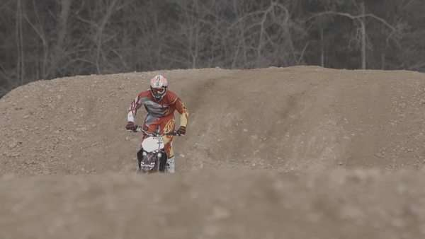 Motocross biker jumps out of frame while approaching the camera Royalty-free stock video