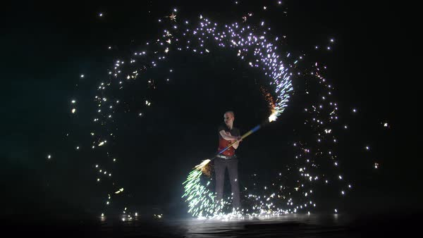 A female artist performing with sparkle contact staff during her stage performance Royalty-free stock video