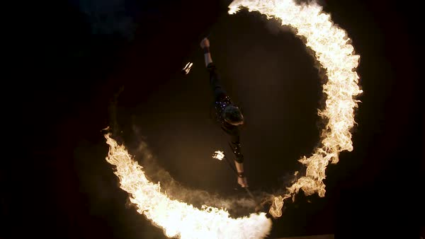A male performer spinning double fire staff during his stage performance Royalty-free stock video