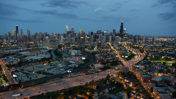 Aerial sunset view of busy metropolitan Chicago city and freeways Royalty-free stock video