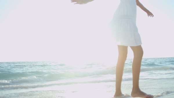 Happy smiling young Latin American girl barefoot on tropical beach Royalty-free stock video