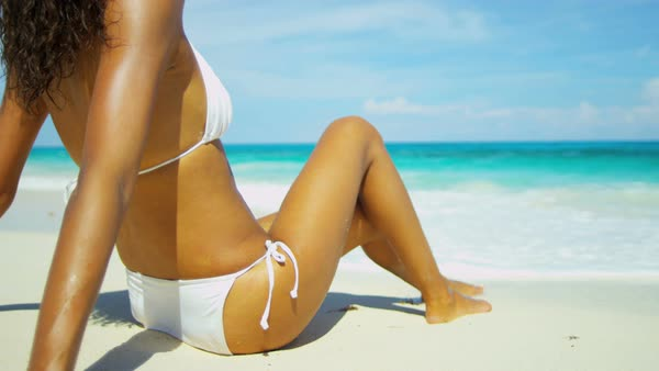 Young ethnic girl sunbathing on a on a tropical beach Royalty-free stock video