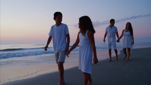 Young family enjoying their vacation together on the beach at sunrise Royalty-free stock video