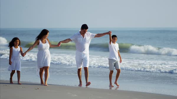 Attractive family walking on beach vacation Royalty-free stock video