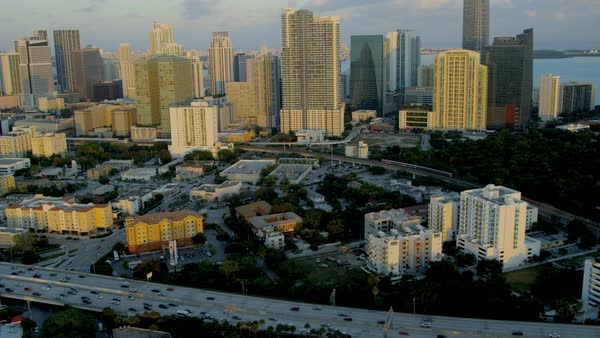 Miami USA - April 2017: Aerial landscape sunset view of Downtown vehicle Highway city Skyscrapers Metropolitan Financial business District Florida USA Royalty-free stock video