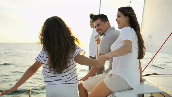 Hispanic parents with son and daughter enjoying outdoor living traveling the ocean on luxury yacht sun flare Royalty-free stock video