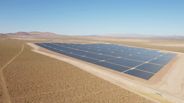 Aerial view Photovoltaic Solar units being used to produce natural clean energy for business industrial production Nevada USA Royalty-free stock video