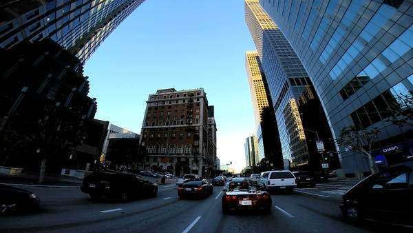 POV drive wide angle downtown vehicle traffic Financial district Los Angeles California USA Royalty-free stock video