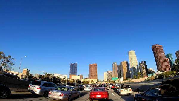 Los Angeles - January 2014: POV wide angle city drive skyscrapers vehicle traffic Los Angeles USA Royalty-free stock video