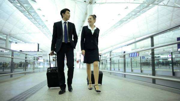 Asian Chinese Caucasian Corporate Team Airport Global Business Travel Royalty-free stock video