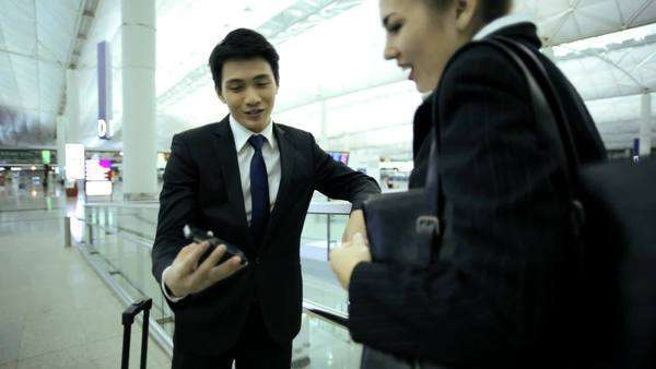 Male Female Asian Chinese Caucasian Airport Passengers Business Meeting Royalty-free stock video
