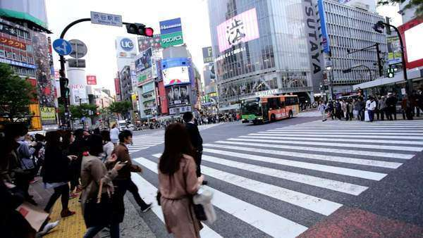 Tokyo traffic Shibuya pedestrian road crossing busy vehicle pollution Royalty-free stock video