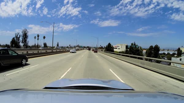 America - September 2014: POV Highway driving city suburban residential district Land vehicle commuter traffic Los Angeles USA Royalty-free stock video