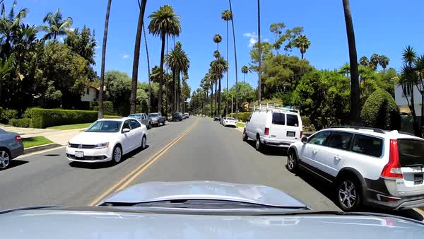 America - September 2014: POV Highway driving city suburban residential district Land vehicle commuter traffic Beverly Hills Los Angeles USA Royalty-free stock video