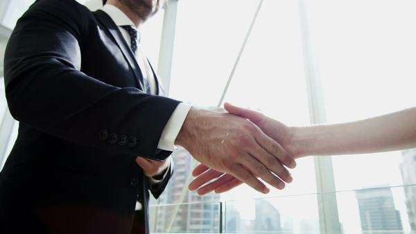 Close-up shot of businessmen and businesswoman shaking hands Royalty-free stock video