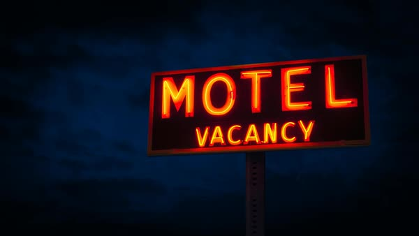 Motel sign lit up at night Royalty-free stock video