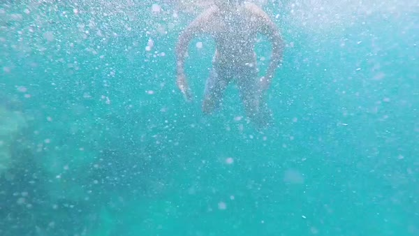 Hand-held shot of a diver floating in the ocean Royalty-free stock video