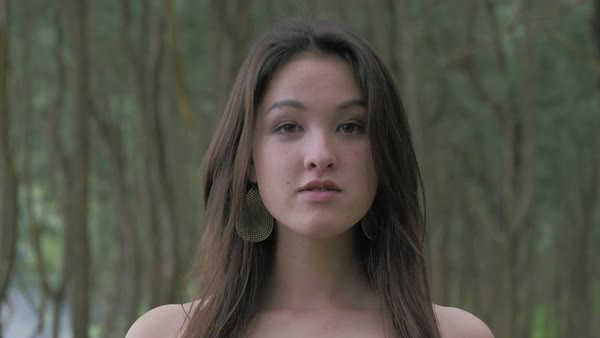 Slow motion of a young woman looking at camera Royalty-free stock video