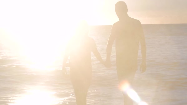 Slow motion of a couple walking on a beach Royalty-free stock video