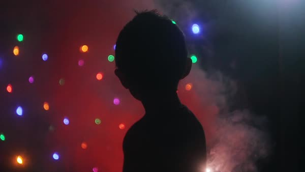 Back view of a boy spinning a sparkler Royalty-free stock video