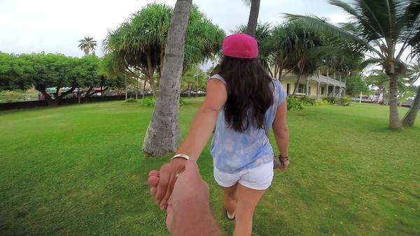 POV sequence holding a woman's hand through numerous tropical locations. Royalty-free stock video