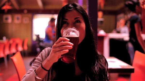 Woman drinking a delicious micro brew. Royalty-free stock video