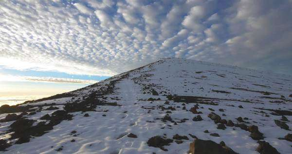 Hiking to Mauna Kea summit in the snow. Royalty-free stock video