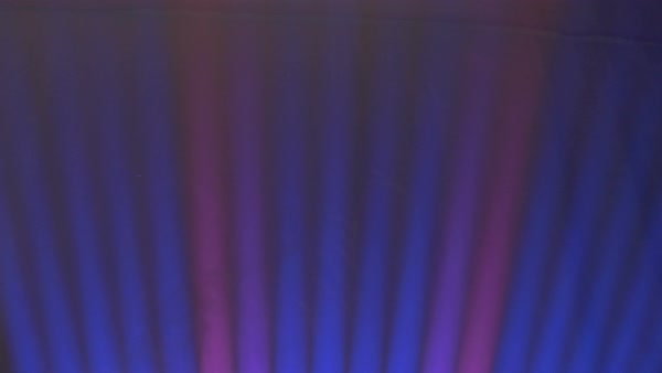 A row of laser light beams, two red and the rest blue, projecting upwards. Close up.  Royalty-free stock video