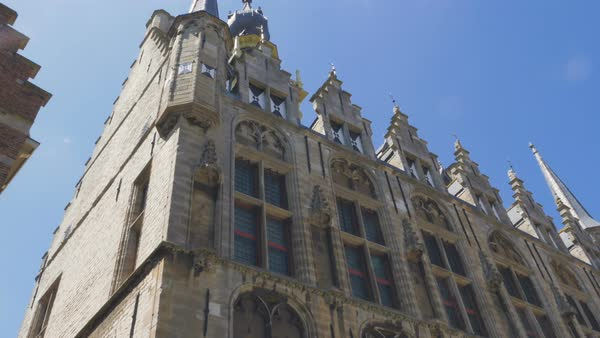 The exterior details of the Middelburg town hall edifice. A display of the exquisite architecture filmed from a low angle on a bright summer day.  Royalty-free stock video
