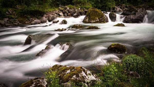 Shot of a meltwater stream in a mountain valley. Royalty-free stock video