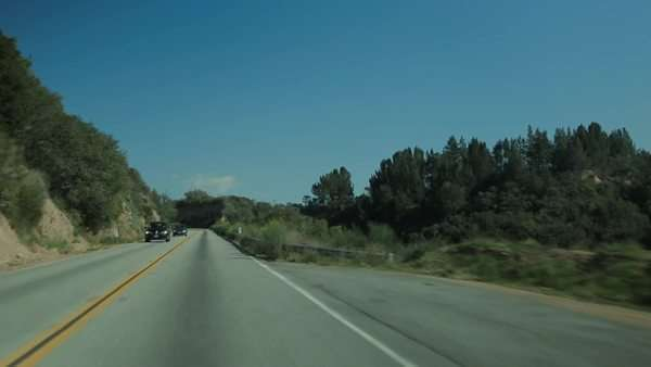Handheld shot of car driving down a road Royalty-free stock video