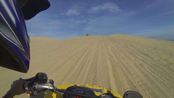 Handheld shot and point of view shot while driving an ATV on sand Royalty-free stock video