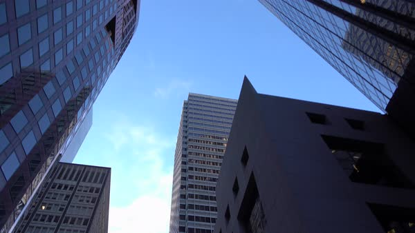Slow motion close-up: driving though busy San Francisco downtown business district with high glassy skyscrapers and big contemporary office buildings Royalty-free stock video