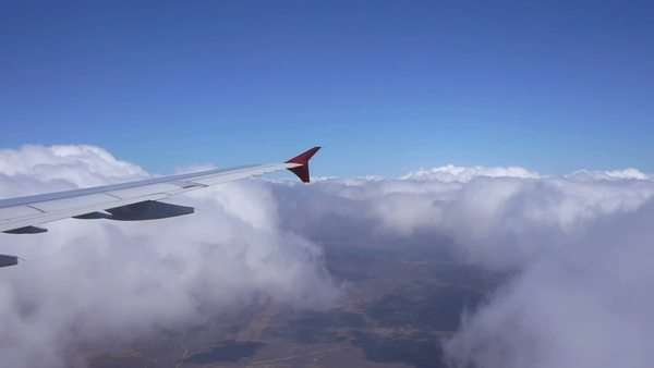 Airplane flying through the clouds Royalty-free stock video