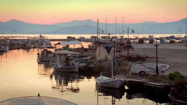 Static very wide shot of moored sailboats at sunset Rights-managed stock video